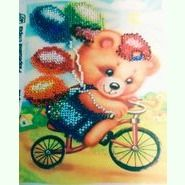 Мишка на велосипеде